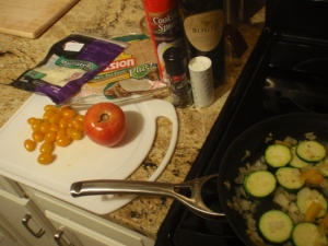 Zucchini, tomatoes (cherry & red), wheat wraps, shredded mozz... and don't forget the red wine!!!