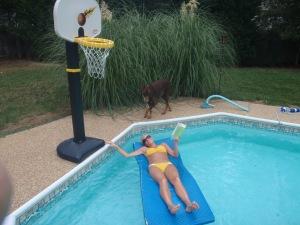 Pool - check.  Sun - check.  Book - check.  Happy girl - check plus!