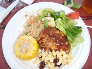 BBQ chicken, corn, fried rice, salad, pasta salad w/ raisins (?)