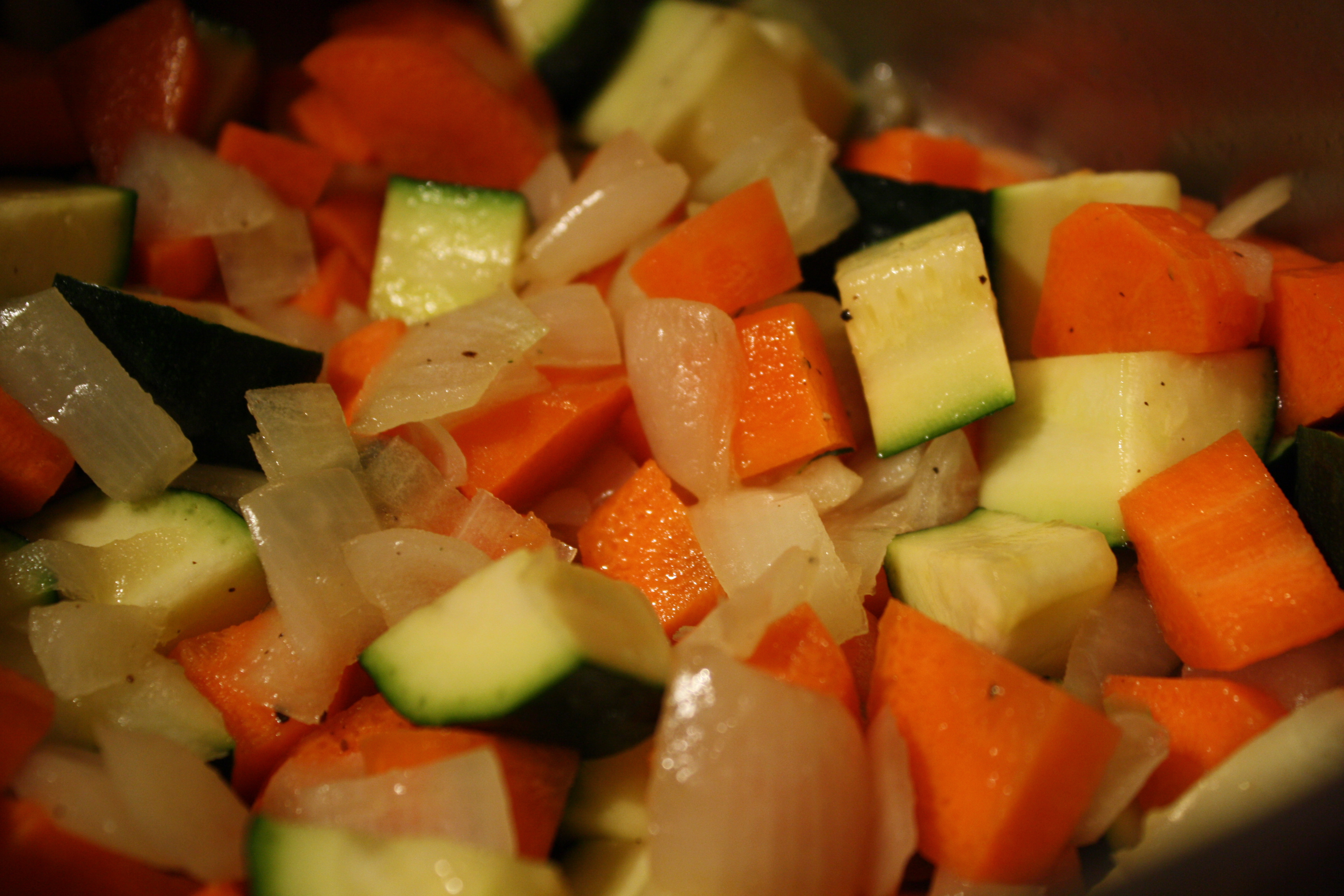 Add beans, tomatoes, basil, oregano and red pepper flakes. Bring to a ...